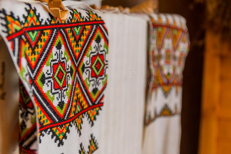 A linen towel with a tarditional Belarusian oranament lies on a table stock photo