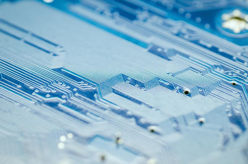 Lines of conductors on a blue printed circuit Board close-up royalty free stock photography