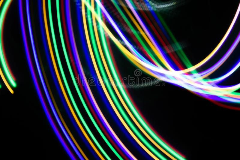 Lines of light on black background. Abstract design in the dark stock photo