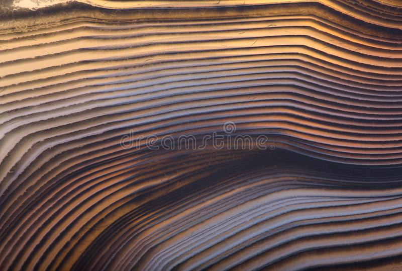 Lines of orange agate macro texture. Background with contrast agate structure royalty free stock photography