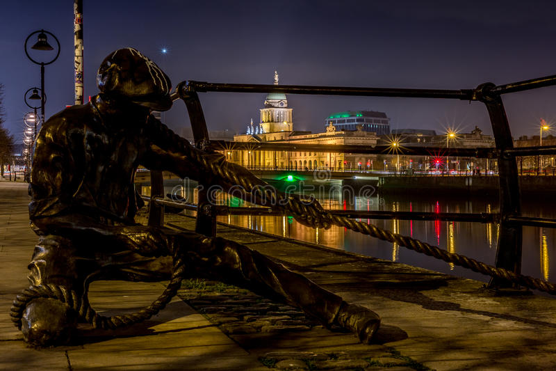 The Linesman statue at Liffey River in Dublin at night, Ireland on January 20th 2017 stock photos