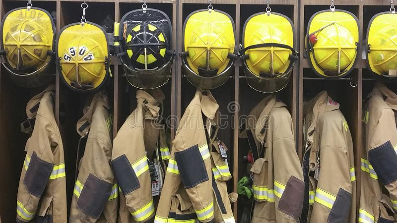 Lineup of Firefighter gear in a firehouse stock images