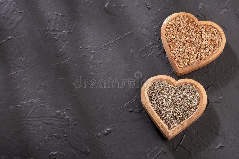 Linfrö och chia - organiskt frö Superfoods Textutrymme arkivbild