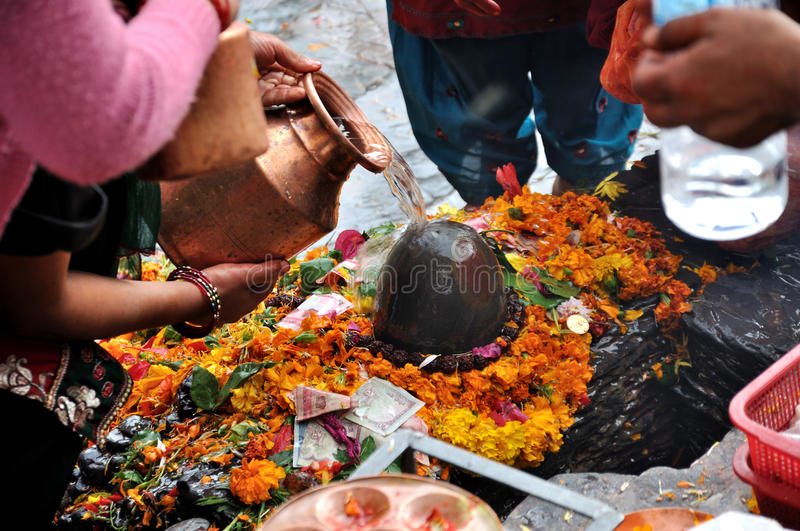 Lingam Worship. In Pashupatinath temple which served as the seat of the national deity, Lord Pashupatinath in Nepal royalty free stock photography