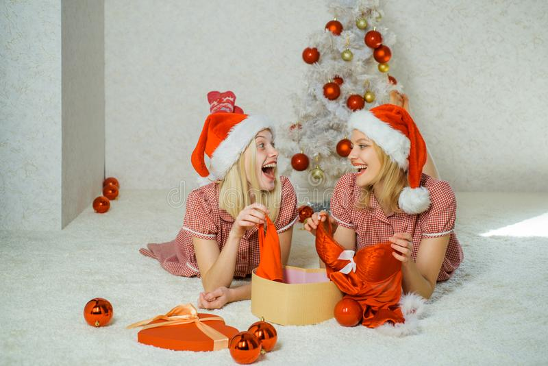 Lingerie for celebrating new year. Christmas Best friends girl. Merry Christmas and Happy Holidays. girls wearing royalty free stock photos