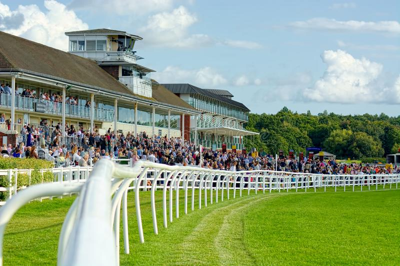 Lingfield Park Racecourse. View of the Grandstand. Hot summer evening horse racing is always popular at the countryside track of Lingfield Park, in Surrey, UK royalty free stock photos
