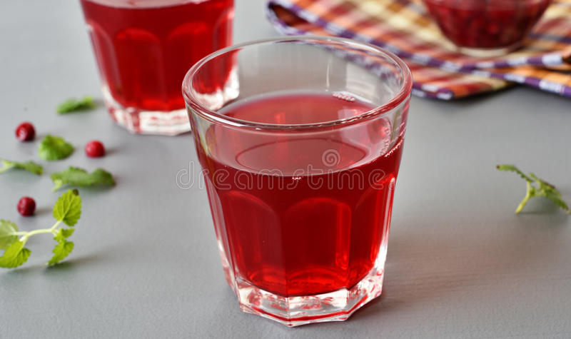 Lingonberry drink. In a glass closeup royalty free stock images