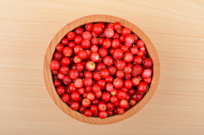 Lingonberry (Vaccinium vitis-idaea). In dish on wooden background stock images