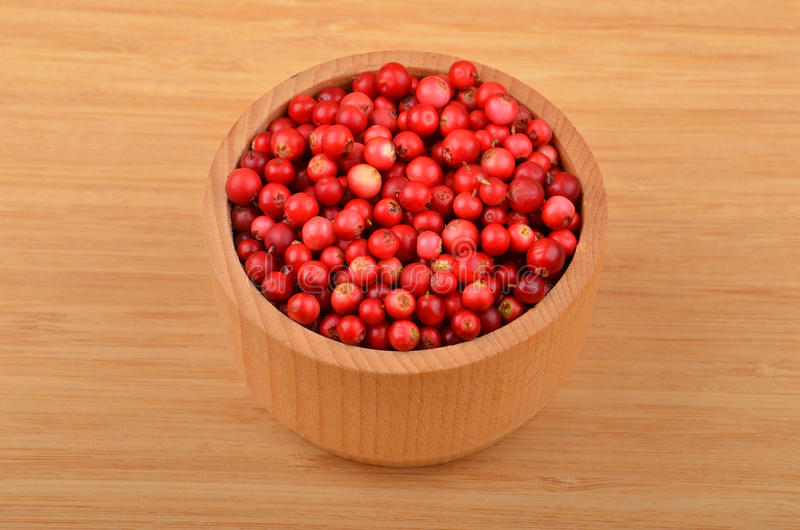 Lingonberry Vaccinium vitis-idaea. In dish on wooden background stock photo