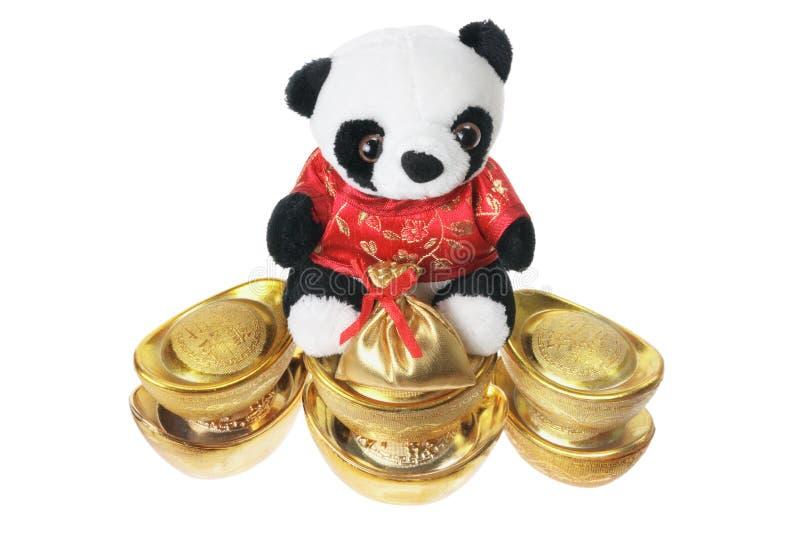 Lingotes macios da panda e do ouro do brinquedo foto de stock royalty free