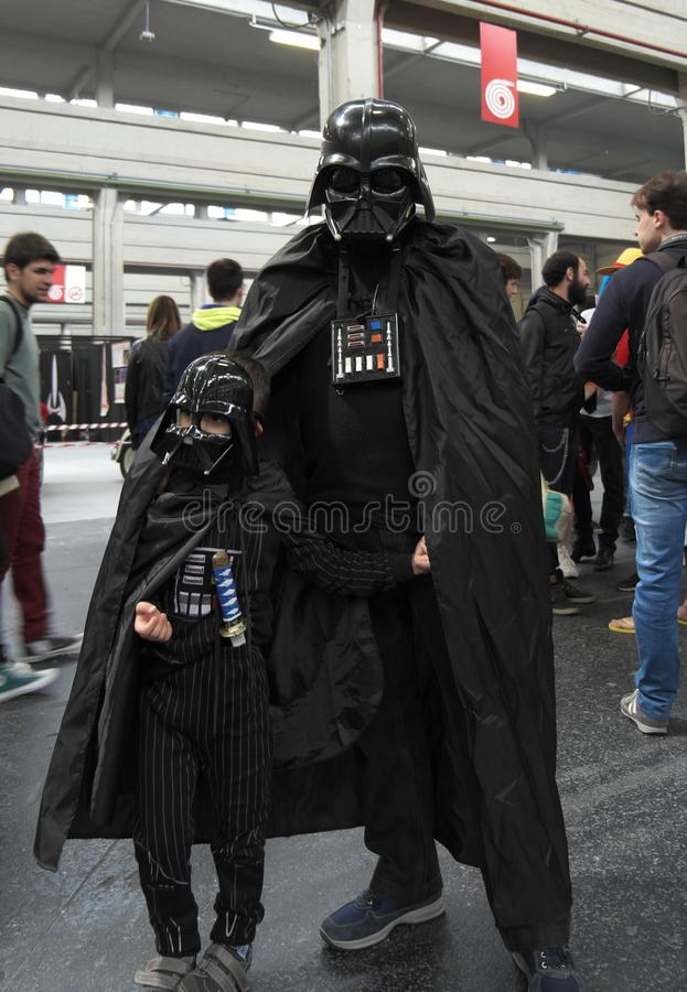 04-18-2015 Lingotto Fiere in Turin, Italy, cosplayers of Darth Vader from Star Wars. 04-18-2015 Lingotto Fiere in Turin, Italy, Torino Comics, Father and son stock images