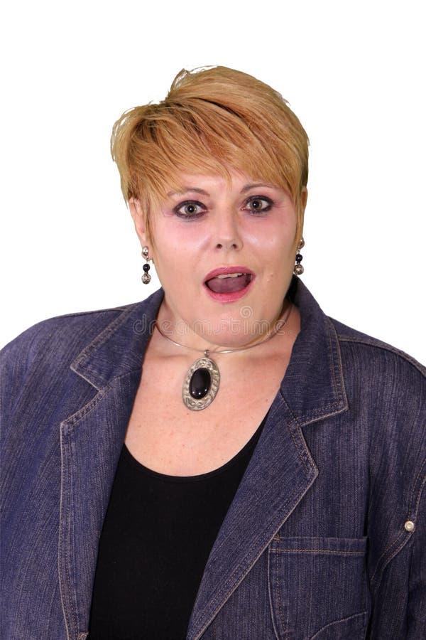 Linguagem corporal madura da mulher - surpreendida imagem de stock