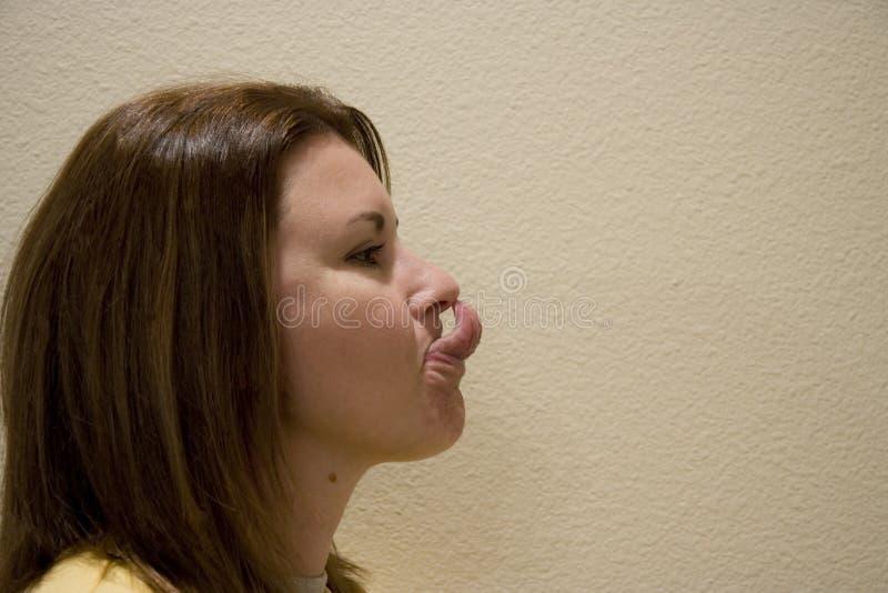 Linguetta della donna immagine stock