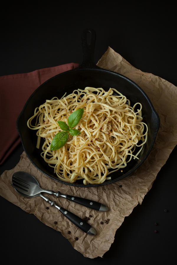 Linguine with Basil in Cast Iron Pan royalty free stock image