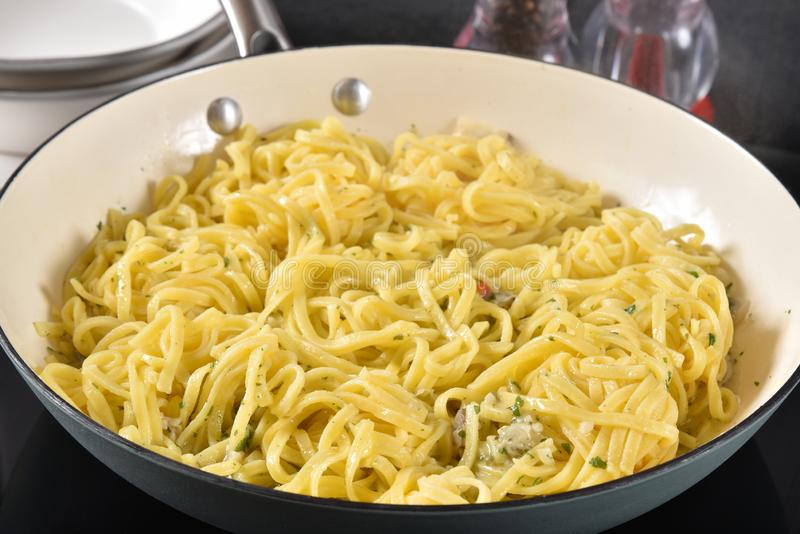 Linguine with clam sauce. Gourmet linguine with clam sauce in a skillet royalty free stock photos