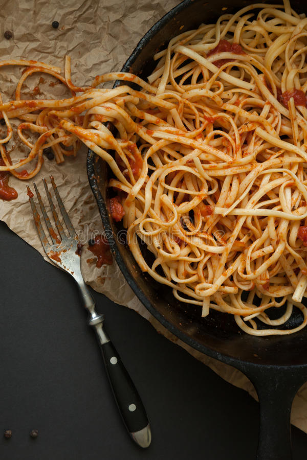 Linguine with Red Sauce in a Cast Iron Pan royalty free stock photos