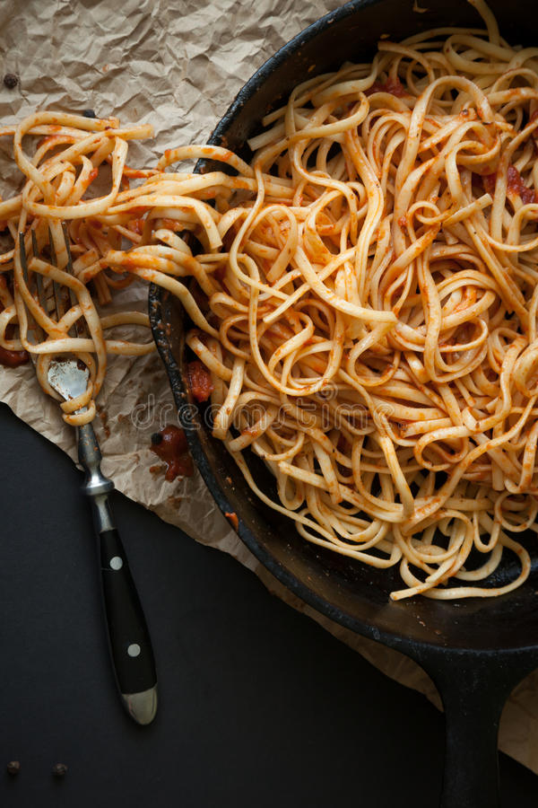 Linguine with Red Sauce in a Cast Iron Pan stock photo