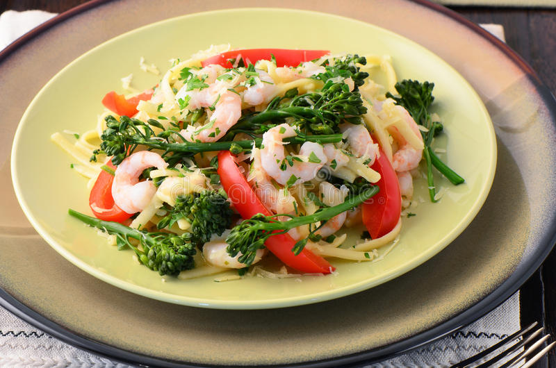 Linguine With Shrimp, Broccolini And Red Peppers Stock Photo