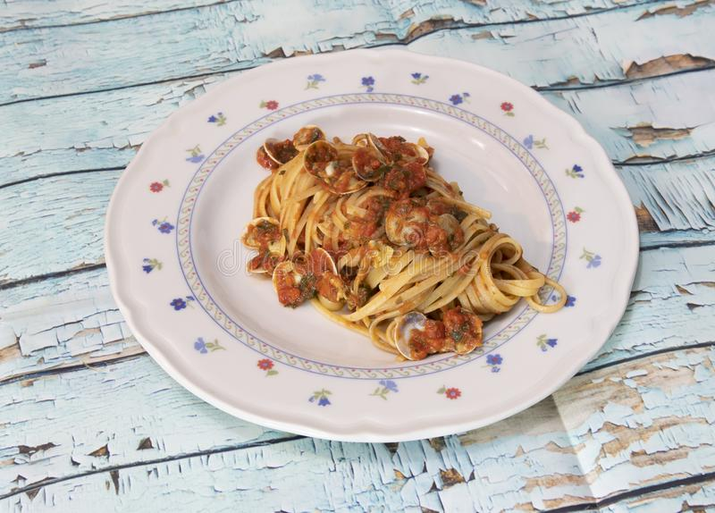 Linguini with clam sauce. Spaghetti or linguini with clam sauce is a very traditional, simple dish found across Italy. Quick and easy one-skillet linguini with stock images