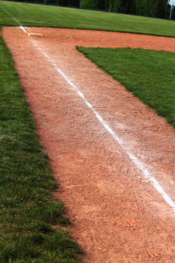 Linha de giz terceira base do basebol imagens de stock