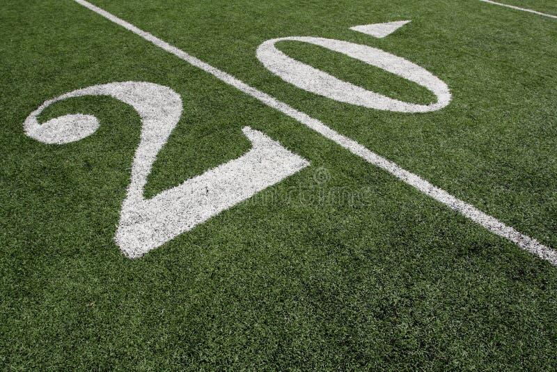 Linha de jardas do futebol americano vinte foto de stock royalty free