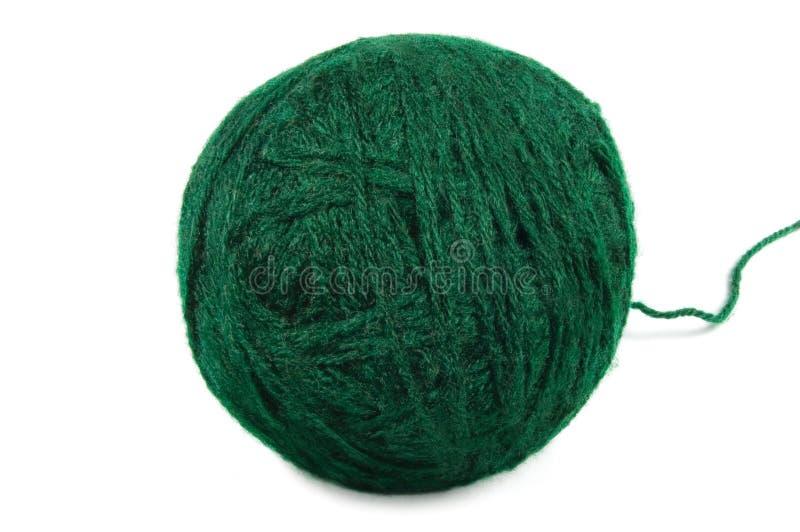 A linha fina verde da esfera de lãs isolou o macro do clew fotos de stock royalty free