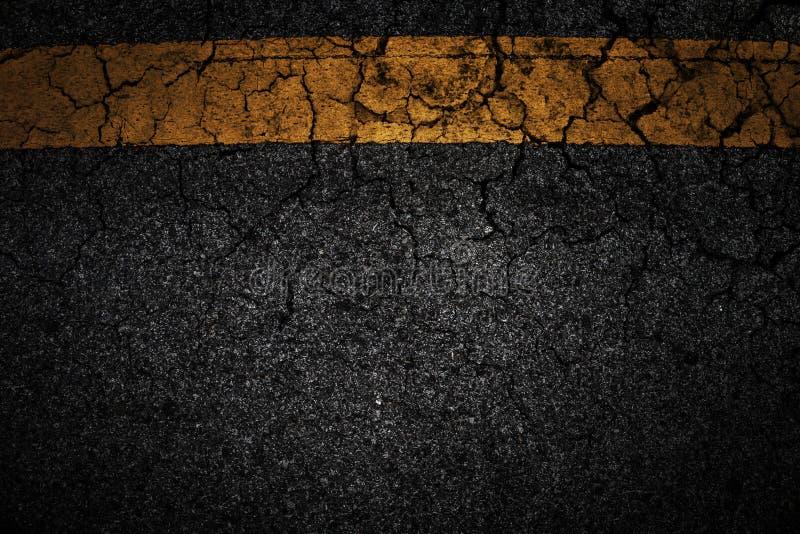 Linha fundo velho do asfalto da quebra do amarelo fotos de stock royalty free
