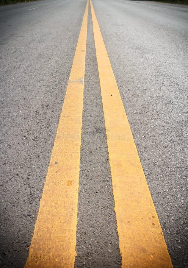 Linhas amarelas dobro imagens de stock
