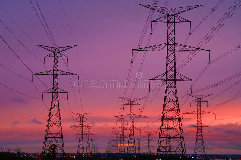 Linhas eléctricas no alvorecer fotografia de stock royalty free
