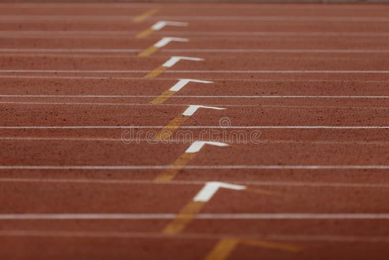 Linie athletische Bahn der Markierung stockfotos