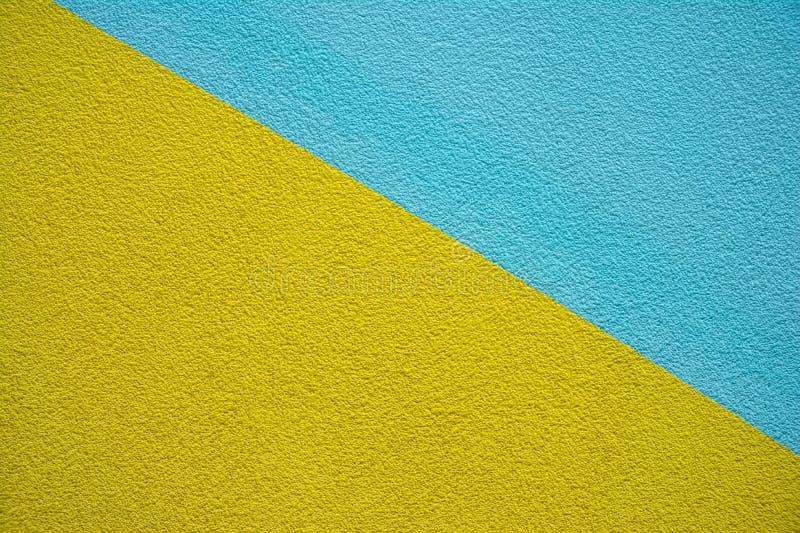 linie diagonalne Kolor żółty & Błękitna textured ściana abstrakcyjny t?o zdjęcia royalty free