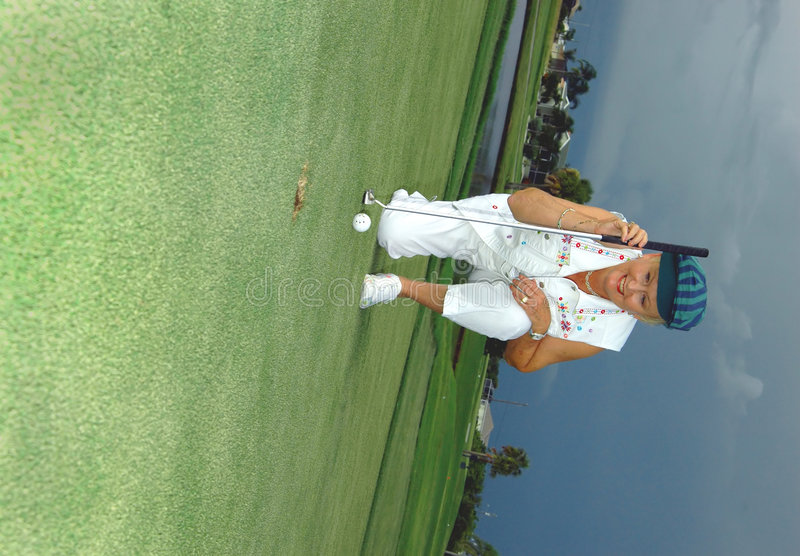 Lining up her putt stock photo