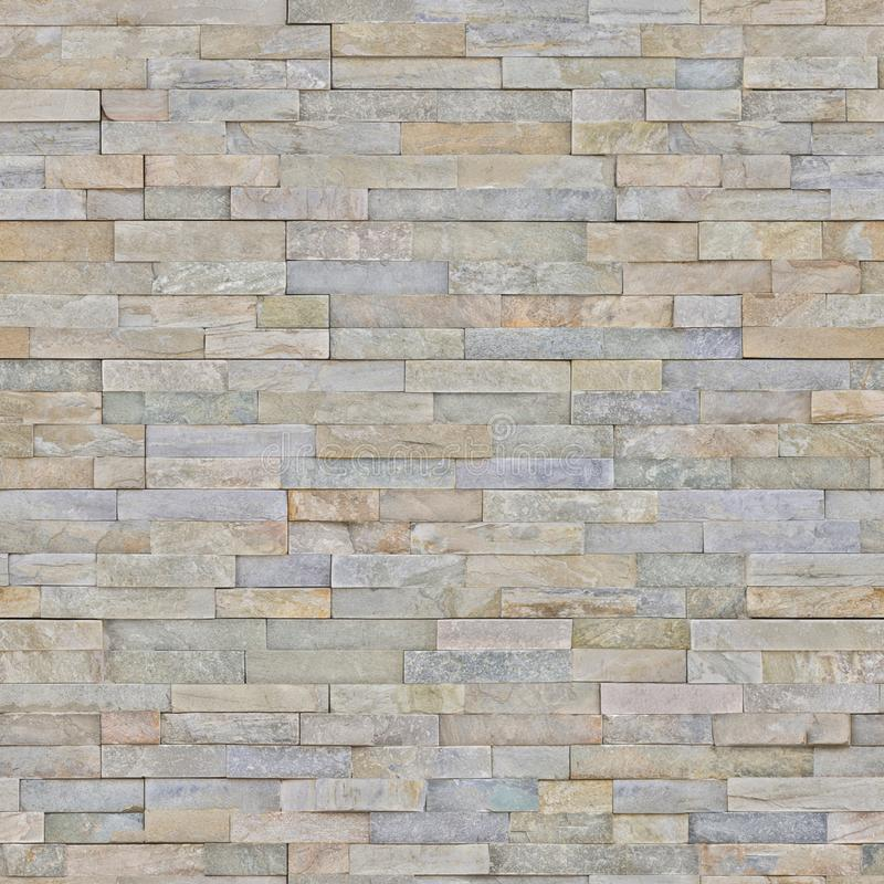 The lining on the wall imitation of natural stone for the facade. Artificial stone on the wall imitation of natural stone for the interior of the house and stock photography