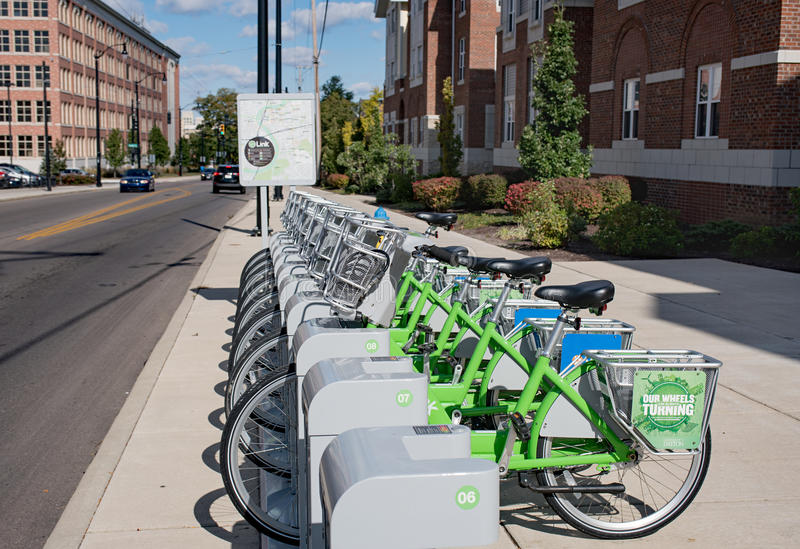Link Dayton Bike Share. Dayton, Ohio, USA - October 18, 2015: Green Link bicycles stand in morning light near University of Dayton waiting to be rented as part stock image