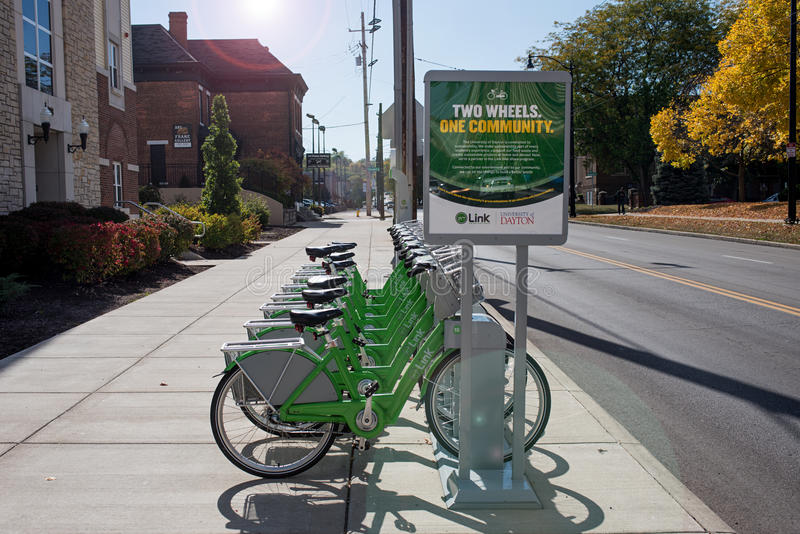 Link Dayton Bike Share by UD in Morning Light. Dayton, Ohio, USA - October 18, 2015: Green Link bicycles stand in morning light near University of Dayton waiting stock photo