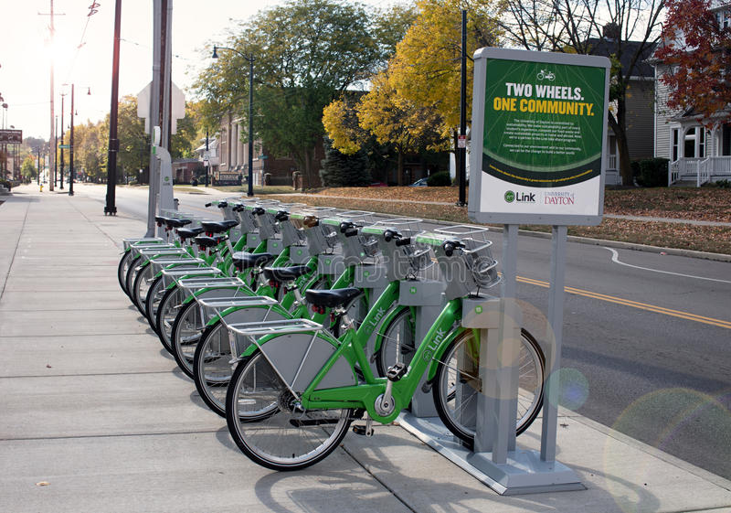 Link Dayton Bike Share by UD in Morning Light. Dayton, Ohio, USA - October 18, 2015: Green Link bicycles stand in morning light near University of Dayton waiting royalty free stock photo