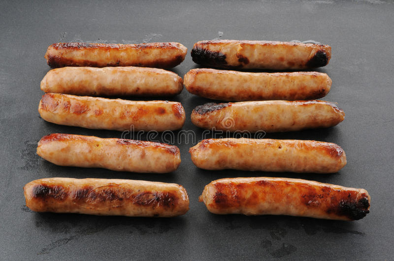 Link Sausage Cooking On A Griddle Stock Photo