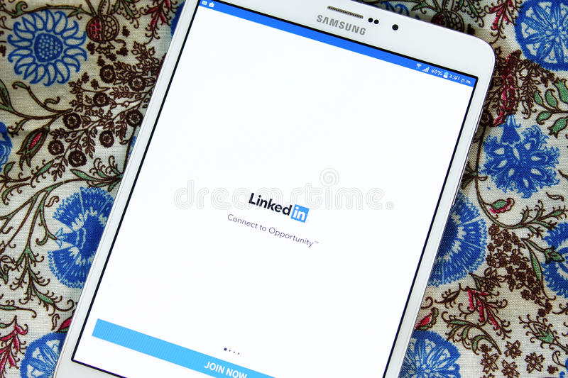 Linkedin android mobile app. Downloading Linkedin android mobile app from google play store on samsung tablet stock images