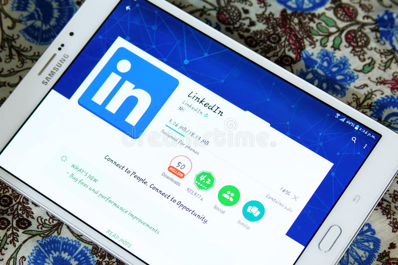 Linkedin android mobile app. Downloading Linkedin android mobile app from google play store on samsung tablet royalty free stock photography