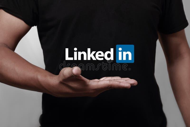 Linkedin. Johor, Malaysia - May 11, 2014: Hand showing Linkedin icon. Linkedin is a famous social networking website, May 11, 2014 in Johor, Malaysia