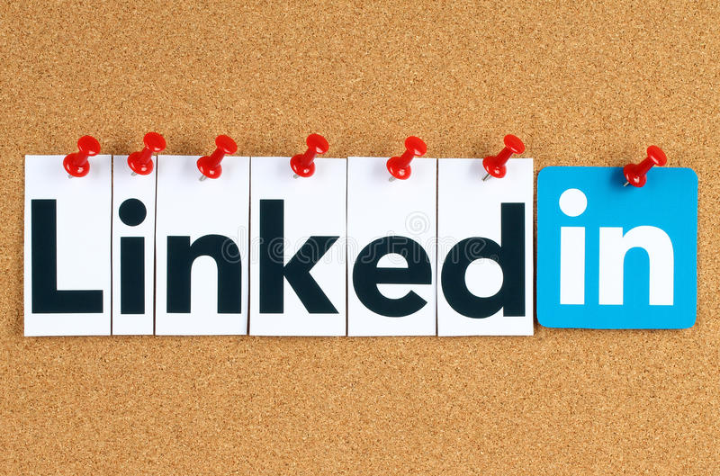 Linkedin logo sign printed on paper, cut and pinned on cork bulletin board royalty free stock photo