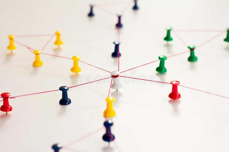 Linking entities. Monotone. Networking, social media, SNS, internet communication abstract. Small network connected to a larger ne. Twork. in paper linked royalty free stock images