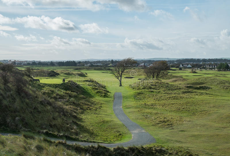 Links course in Ireland. View over links golf course with path leading down from tee to fairway stock image