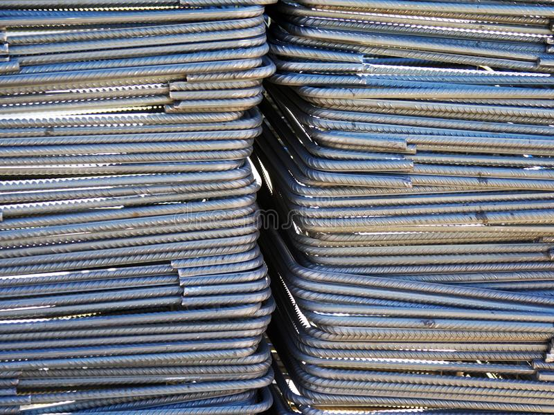 Links , steel reinforcement stacked and ready to be used. Metal links of grade 43c to be used in construction and to bind together the columns and beams main stock photo