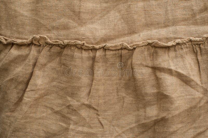 Linnetextur för naturligt tyg, beige färg, unbleached material för design arkivbilder
