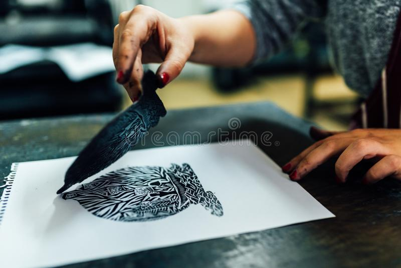 Linocut. manual printing on the machine stock photos