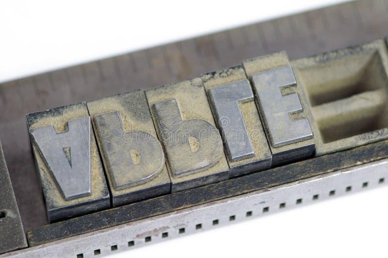 Linotypetekst in dichte de appel van de stokspelling royalty-vrije stock afbeeldingen