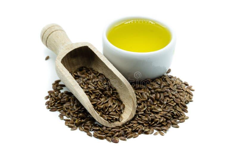 Linseed i linseed olej odizolowywający na białym tle obrazy stock