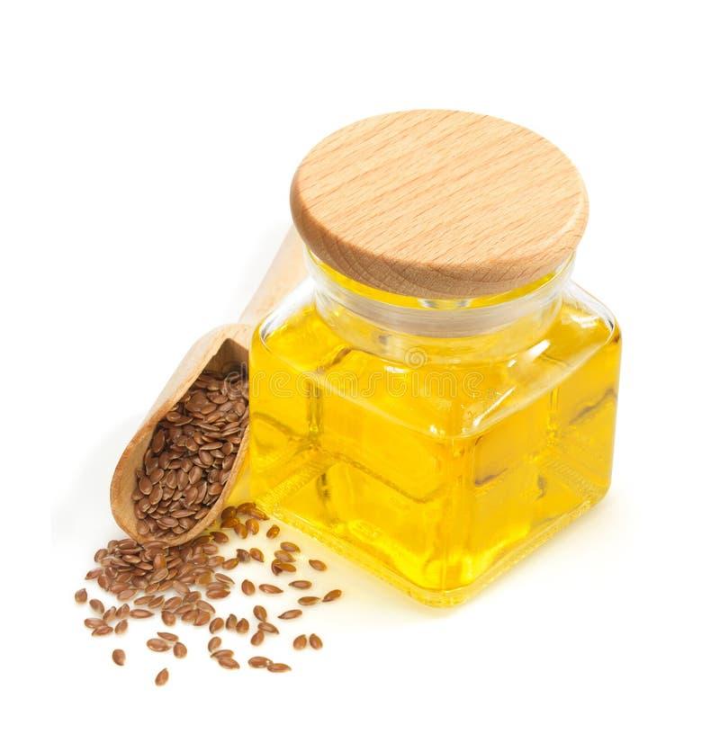 Linseed olej w butelce odizolowywającej na bielu zdjęcia stock