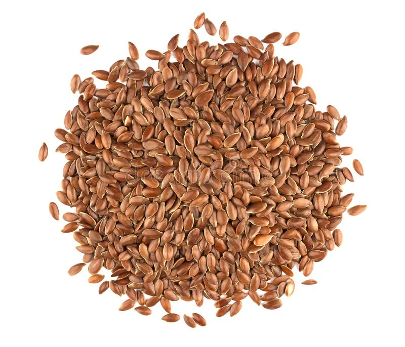 Linseed on a white background. Also known as Linseed, Flaxseed a. Flax seeds isolated on white background. Also known as Linseed, Flaxseed and Common Flax. Pile royalty free stock photo